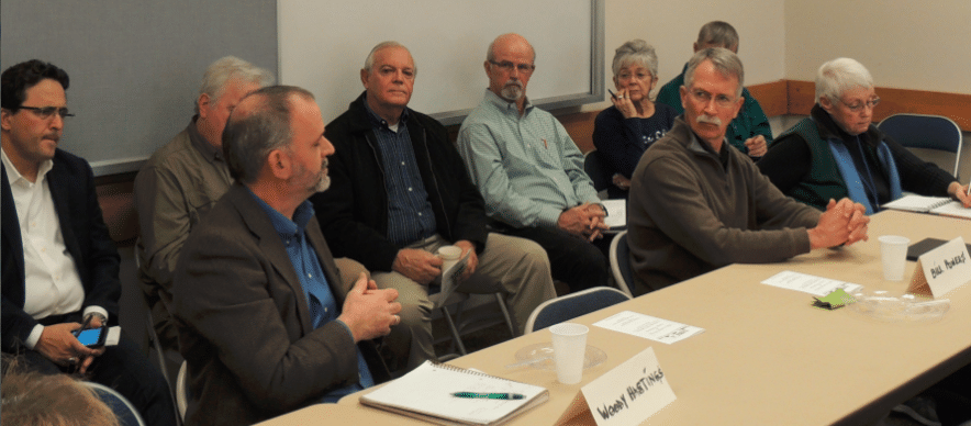 Woody Hastings (front row left) and Bill Powers (front row right) share their experience and knowledge of the renewable energy model known as Community Choice Aggregation while state, county, water and business leaders listen and take note.
