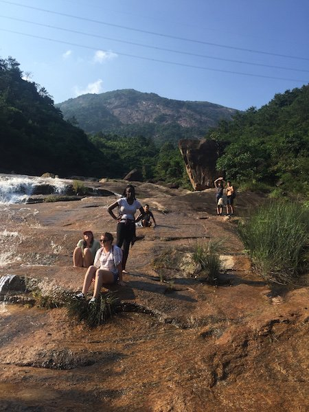 YAB member Katie Morrison and other AYLP students enjoy a waterfall and the view on a visit to the Chinese countryside.