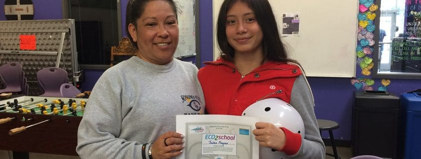 Jackie Fragoso of Roseland University Prep holding her ECO2school certificate
