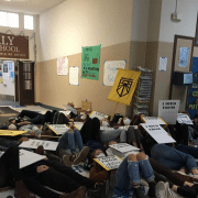 "A staged ""die-in"" at Santa Rosa mall to demonstrate the perils of climate change"