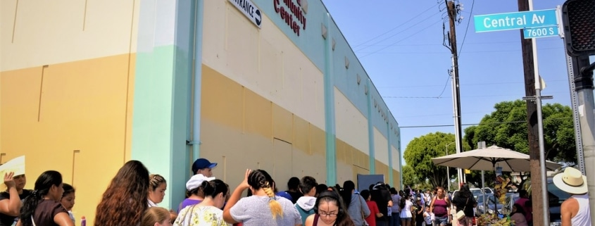A line of people needing assistance is wrapped around the corner at the Salvation Army Seimon Center in South East Los Angeles, during the Feed LA event, Aug, 11. [U.S. Air Force photo/Lina Satele]