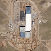 "Outside of Sparks, Nevada, construction of Tesla's ""Gigafactory"" progresses over a 15-month period. The enormous plant now manufactures the unique battery packs that power Tesla's new Model 3 vehicle. Data analysis firms like Genscape use Planet imagery and other complementary datasets to analyze the health of the world's manufacturers."