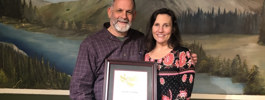 Woody Hastings and his wife June Brashares accepting the Ernestine Smith Environmentalist of the Year award and the Pat and Ted Elliot posthumous Lifetime Environmental Achievement