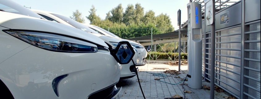 Electric Vehicles Charging at a Station, by Stivabc, found on https://pixabay.com/photos/parking-space-car-electric-car-1678181/