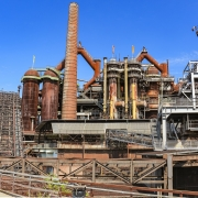 Steel production factory by knollzw found on https://www.needpix.com/photo/1179741/industry-blast-furnaces-steel-production-industrial-heritage-heavy-industry-iron