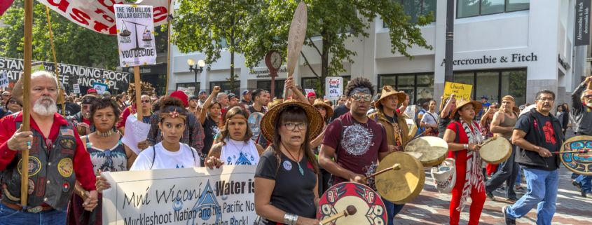 Protesters march against oil pipeline in solidarity with Native People at Standing Rock in 2016 rally by John Duffy